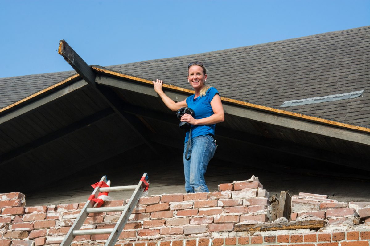 Jenny Wolfe inspecting the decking of the gable roof of the 1898 historic Waterworks pumping station